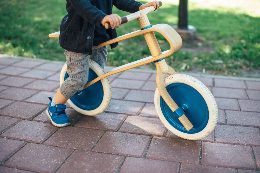 A child practices riding their bike